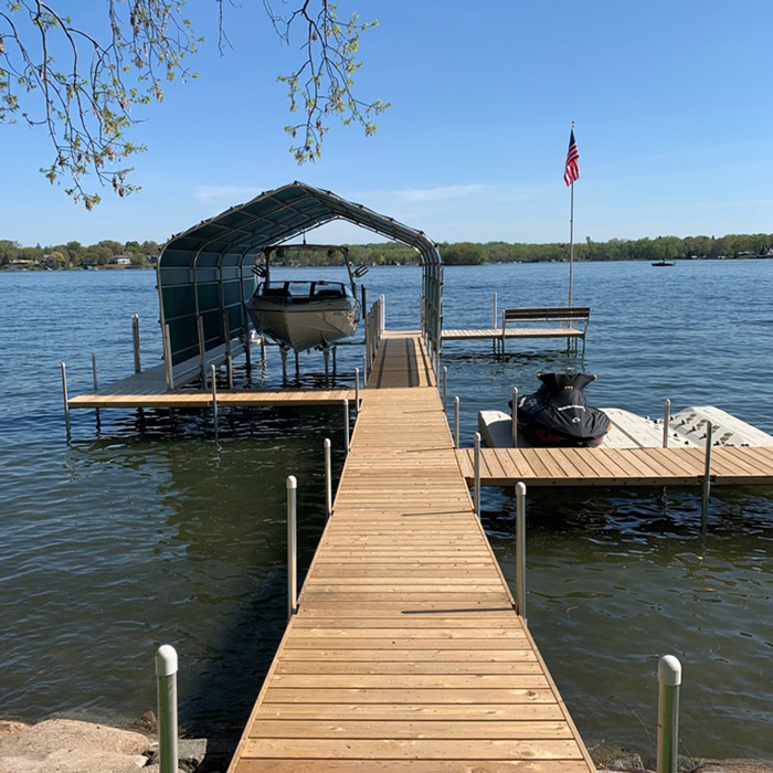 beautiful boathouse and cedar dock on Lake Minnetonka
