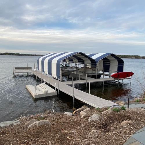 blue and white striped boathouses on Lake Minnetonka