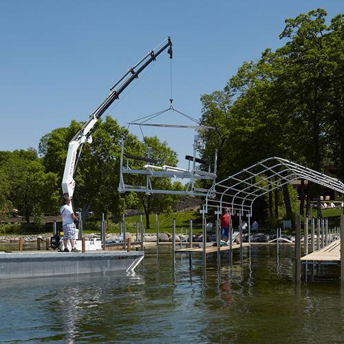 Crepeau Docks barge installing boat lift
