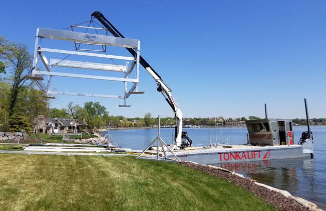 Crepeau Docks barge installing new boathouse