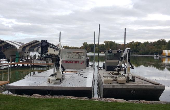 2015 and 2008 barge side by side on Lake Minnetonka