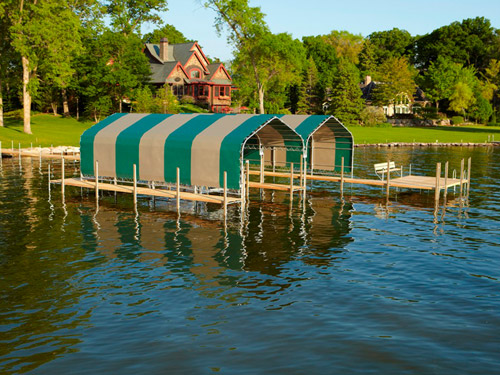 green and tan striped boathouses on Lake Minnetonka