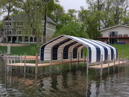 navy and white striped boathouse on Lake Minnetonka