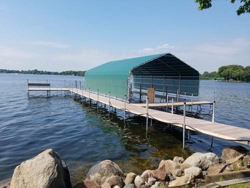 green boathouse on Lake Minnetonka