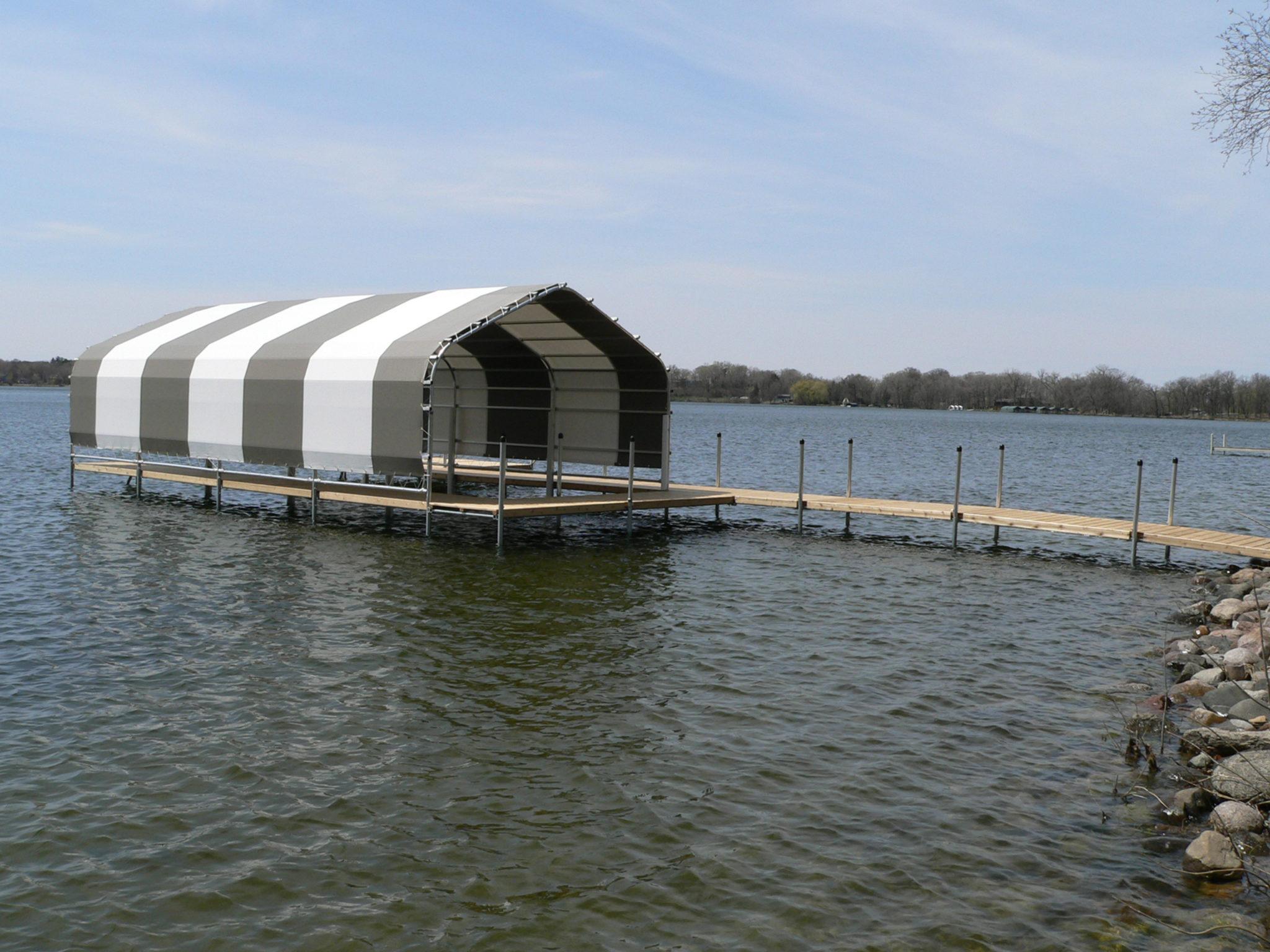 gray and white striped boathouse on lake Minnetonka