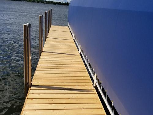 cedar dock beside blue boathouse
