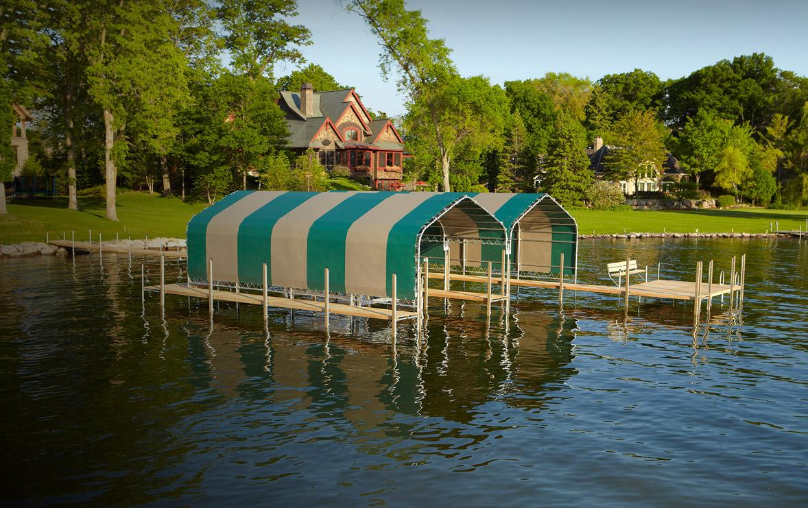 Crepeau Docks green and tan striped boathouses on Lake Minnetonka