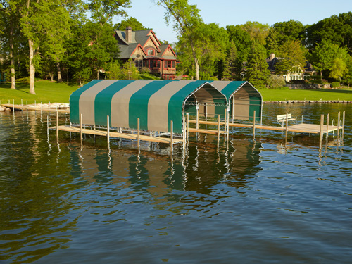beautiful green and brown striped boathouses