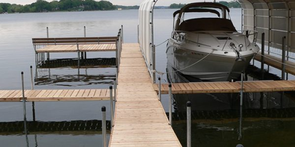beautiful cedar dock on Lake Minnetonka on gray morning